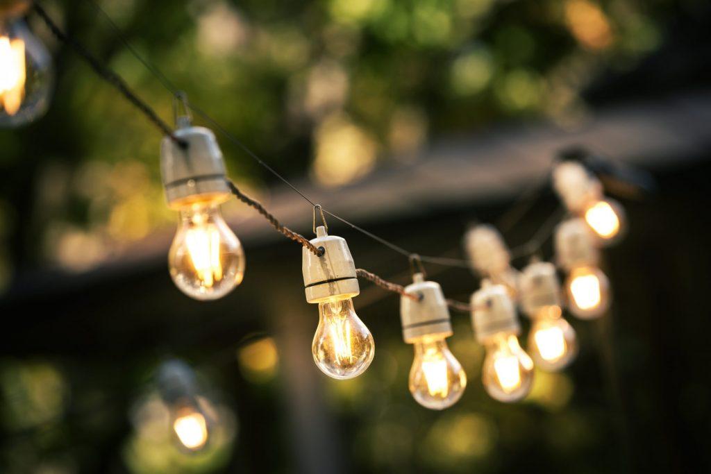 laurel-hill-gardens-outdoor-string-lights-hanging-on-a-line-in-backyard
